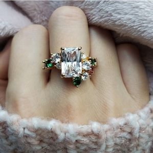 New Gorgeous Emerald Cut White Sapphire Ring